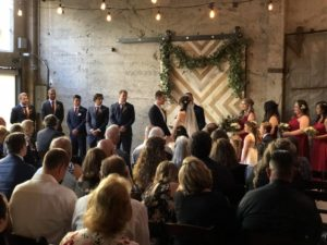 Ceremony in front of the barn door at Luce Loft